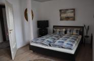 Schlafzimmer der Wohnung Dennis von der Pension Kawa in Delmenhorst